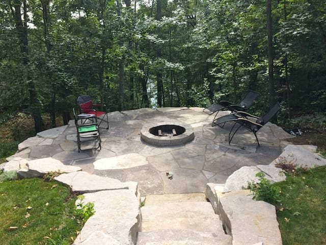 Enjoy the fire pit overlooking the water below.  The perfect spot for relaxing and enjoying the outdoors.