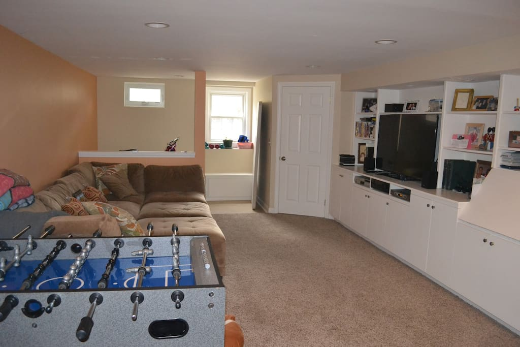 Kids and adults will enjoy our basement family room with a large screen TV, comfy sofa and foosball table.