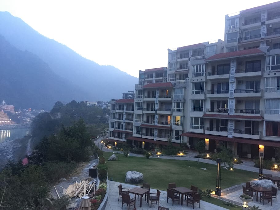 Our privately owned  apartment at the Aloha resort . This is the front side of the complex which has huge balconies to enjoy the view of Himalayas mountains ranges with Ganges flowing by .. The swimming pool and Patio Restaurant is located here as well .