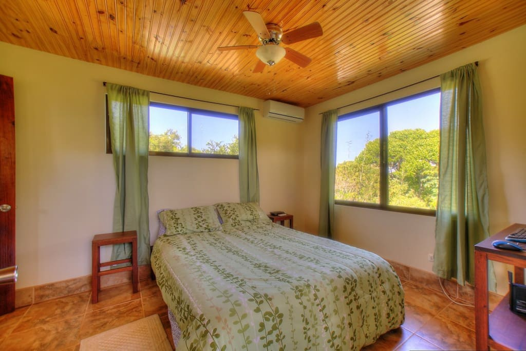 Comfortable upstairs bedroom with air conditioning