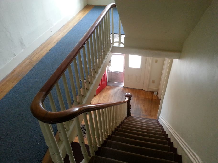 Stair hallway leading up to the 3rd floor Airbnb apartment.