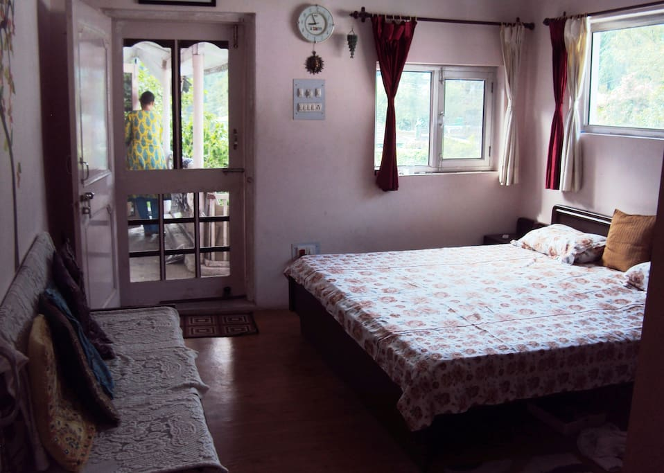A comfortable bedroom with attached bathroom and dressing room