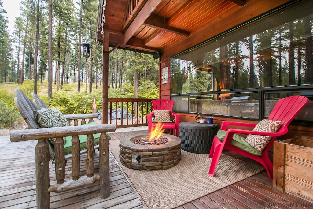 Back deck area with propane firepit and gas grill. National forest backs the cabin so it is nice and private.