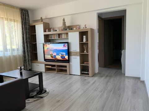 شقة بغرفتين في بوسيوم مع موقف سيارات مجاني