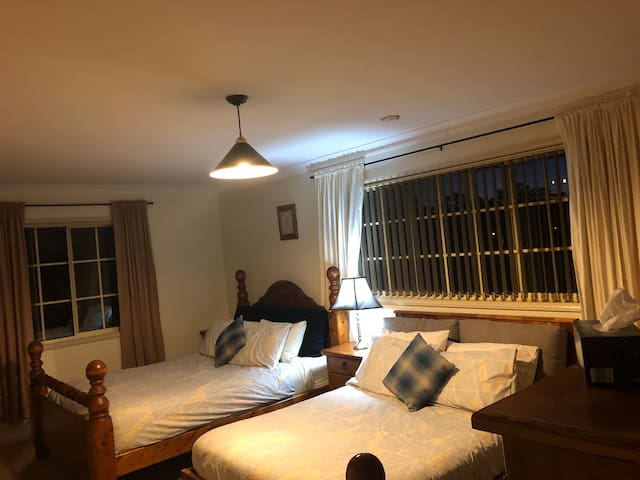 Upstairs bedroom with 2 beds. 1 queen & 1 double