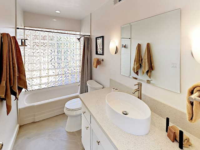 The en-suite bathroom in the 2nd bedroom has a tub/shower combination.