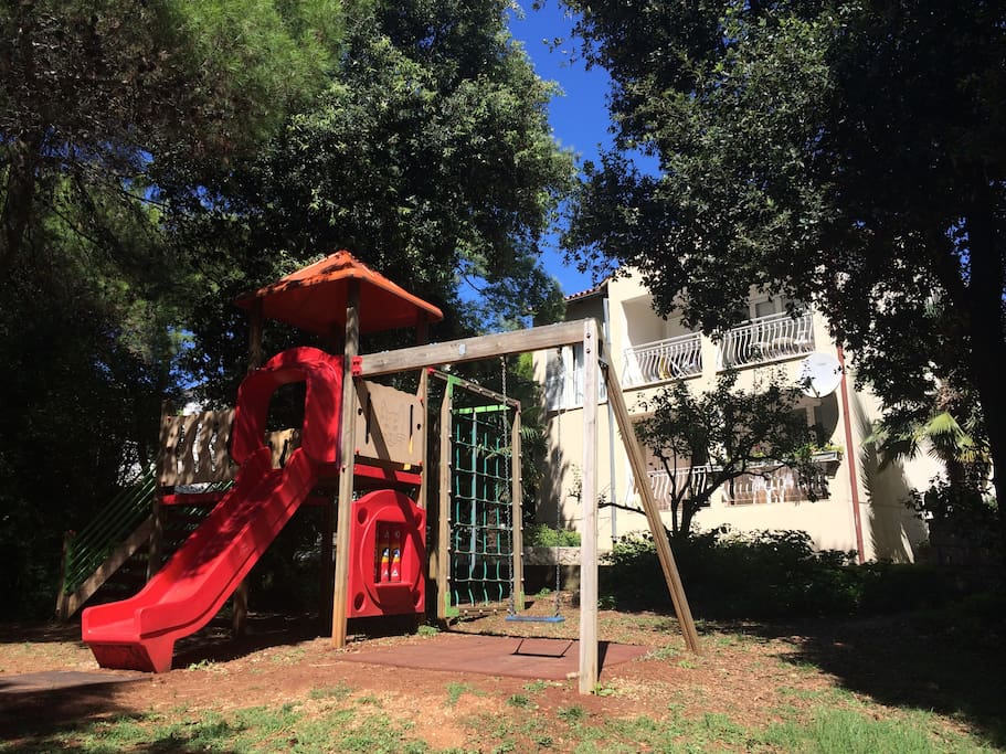 The playground and the apartment on the back