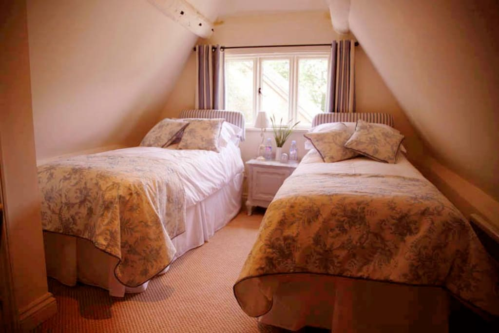 A calm and peaceful room with two comfy beds for a great night's sleep.
