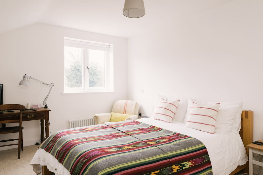 Double bed with comfy cushions and kingsize duvet cover