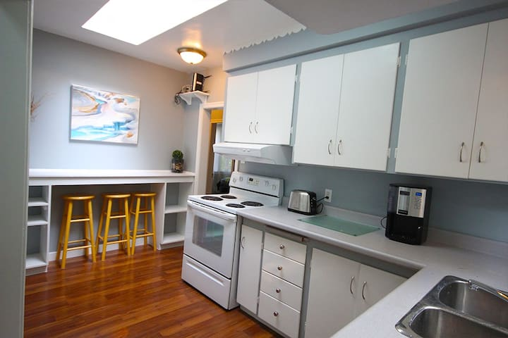 This is the kitchen that is located in the upstairs for the guests. Has a nice Skylight that lets in lots of natural light. It is fully stocked with pots, pans and other essential wares. Along with coffee, tea, spices, etc.