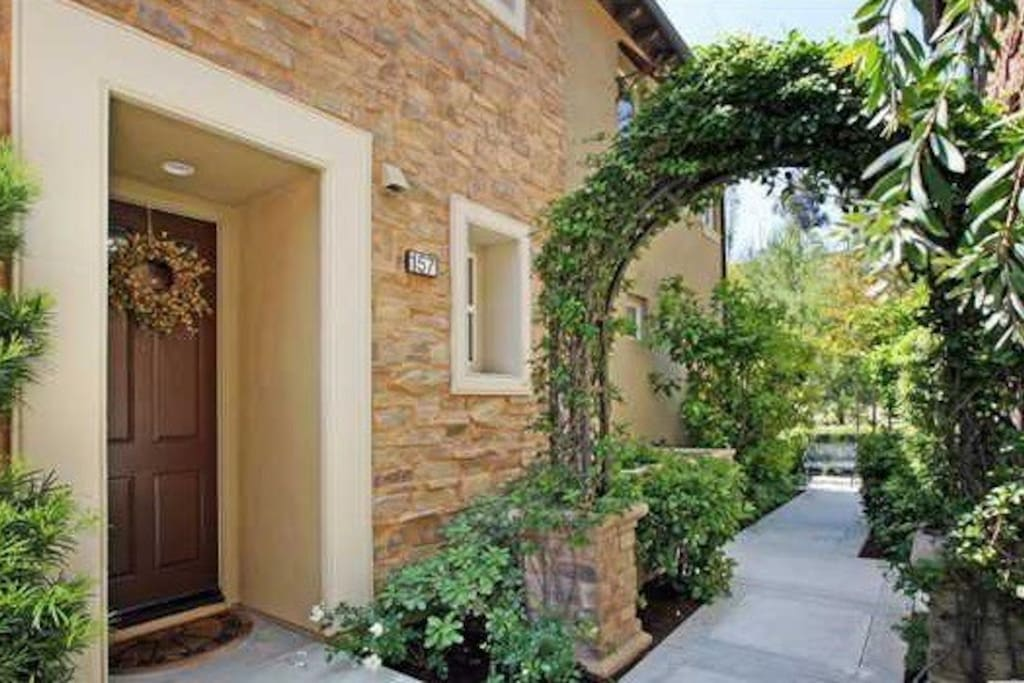 Front Door with Lush Landscape