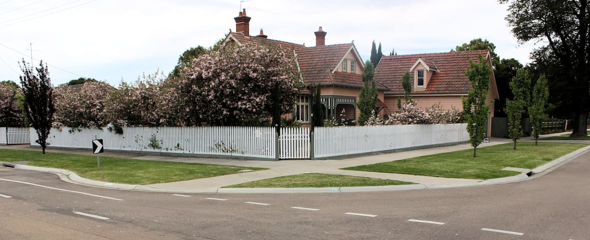 Picket fence showcases this 1910 property