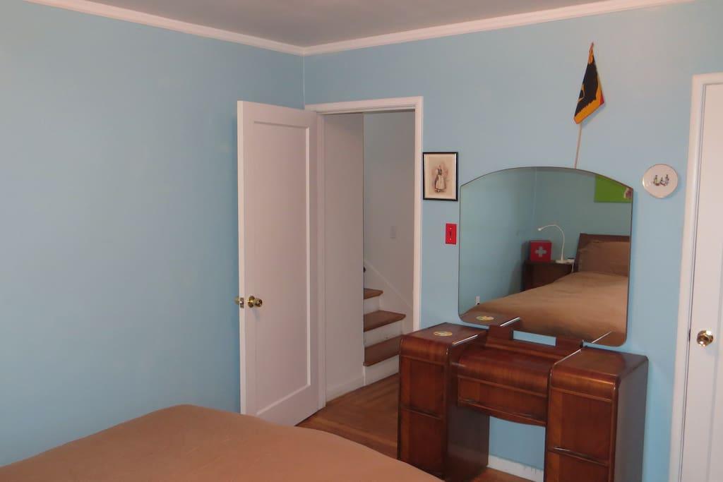 Your room is one door away from house's main bathroom.