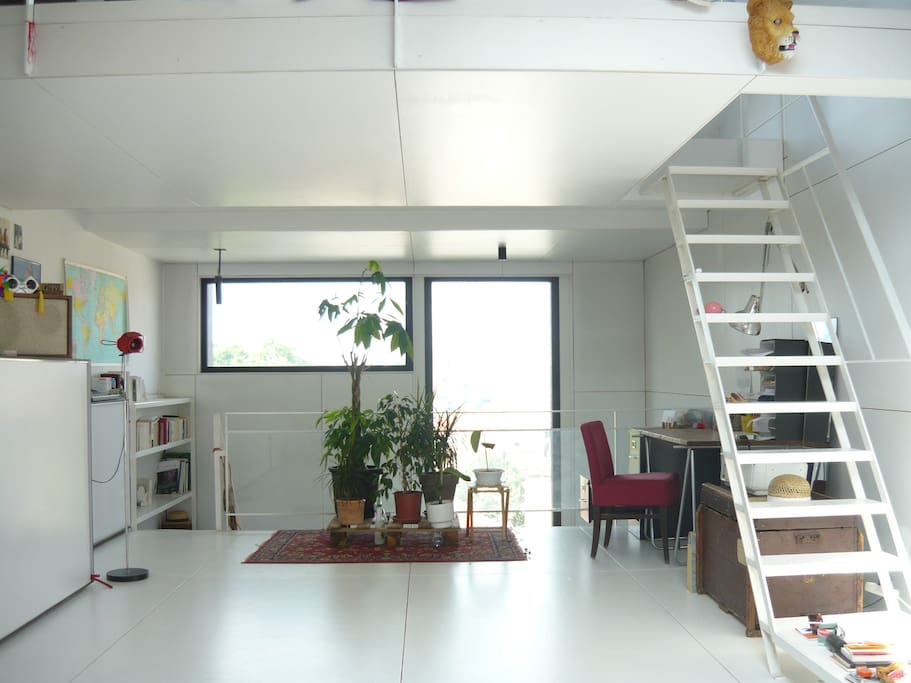 living room with kitchen and below the large terrace