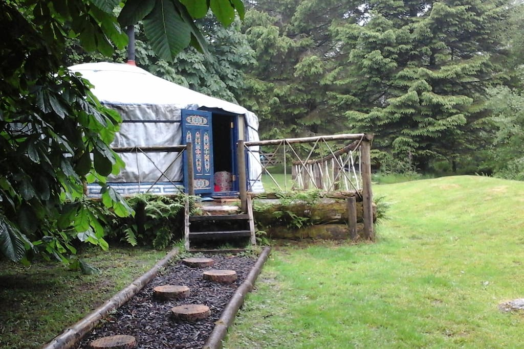 the stepping stone path from the rustic kitchen to Lake Yurt