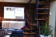 Stairs up to loft with queen bed