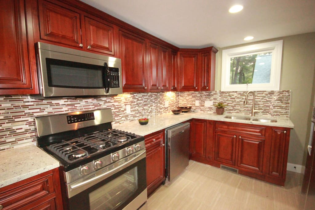 Modern kitchen with fully stocked kitchen ware, pots and pans to cook to your hearts content