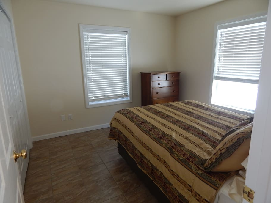 Queen Bed with closet and dresser space