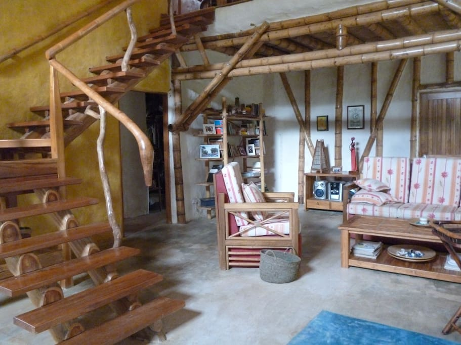 a house of bamboo with wooden furniture all self-made by the owner