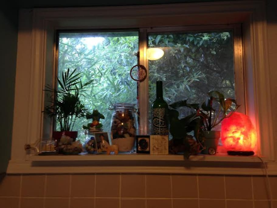 Our little kitchen window with treasures we've collected along our journeys.