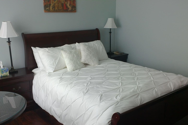 Queen sleigh bed with duvet