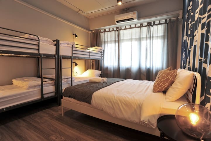 Bedroom 5 on the 5th floor - king bed and two bunk beds