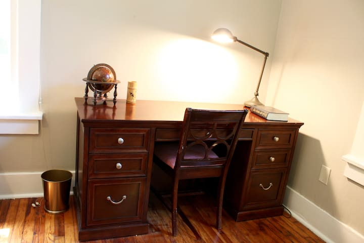 There's plenty of office space in the back bedroom.