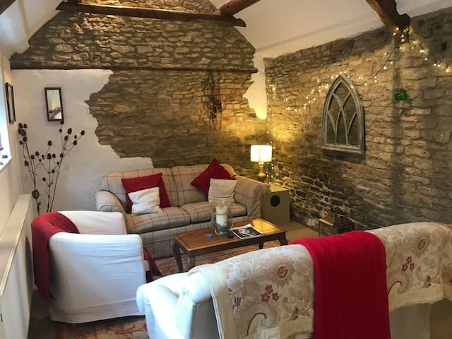 The Old Wash House. Converted into cozy room to relax after a day walking the Cotswold Hills