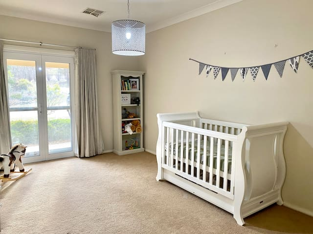Fourth bedroom with cot / toddler bed. Additional single mattress available to add another bed to this room.