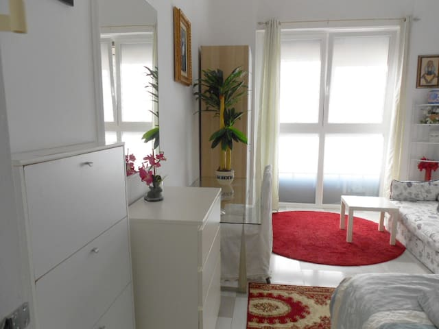 Private white room in shared apartment