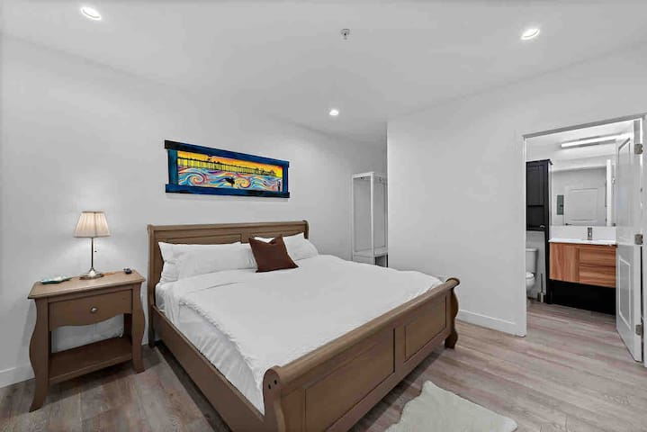 "Bedroom 2, with comfy king size bed, full en-suite bathroom (tub & shower) and 42"" smart tv."
