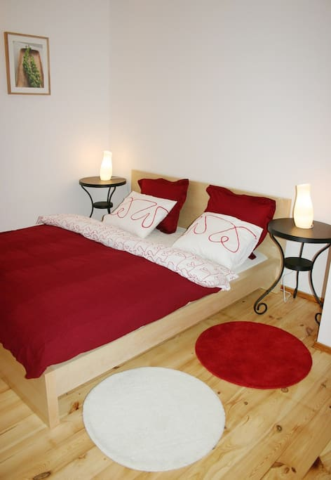 The large comfortable bed in the bedroom area