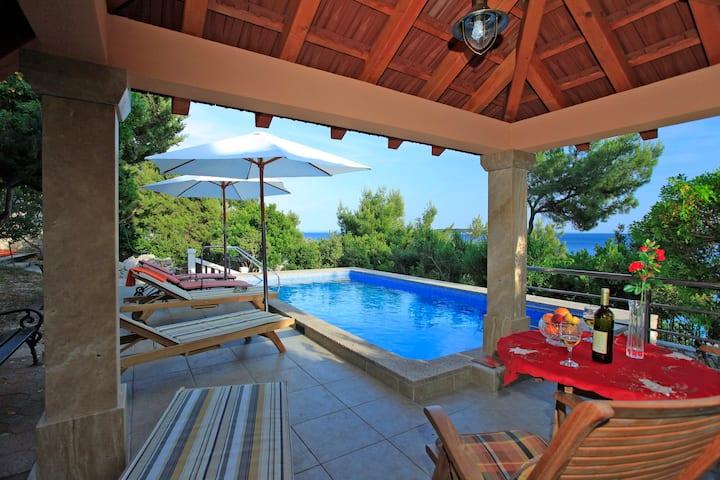 Beach villa with pool, boath dock