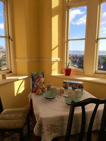 Breakfast room with sweeping views across Swansea Bay.