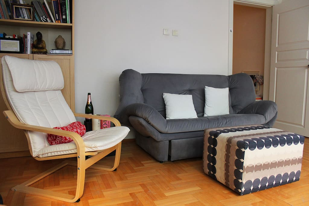 Comfortable and cosy living room with a balcony overlooking the common garden