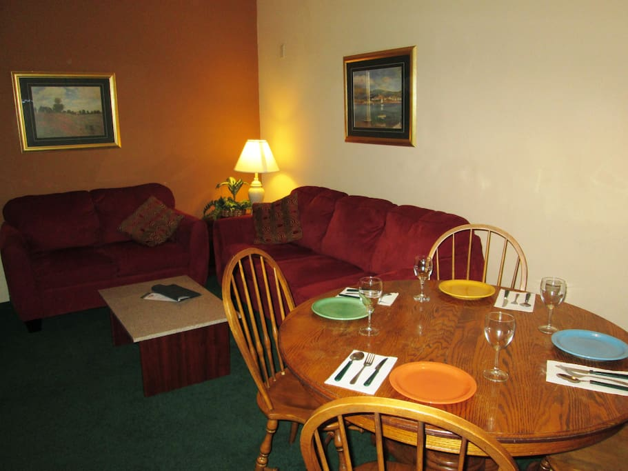 The Living Room/Dining Area is cozy and inviting!  Also, has a large screen LED TV with cable and DVD player