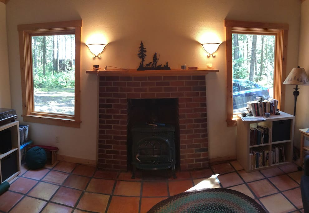 Wood stove keeps the cabin cozy in winter.  There is also a wall-mounted propane heater.