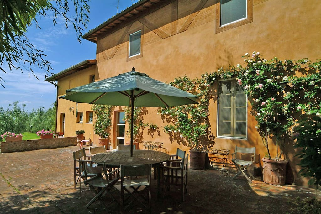 The sunny terrace by the Villa with eating area for ten