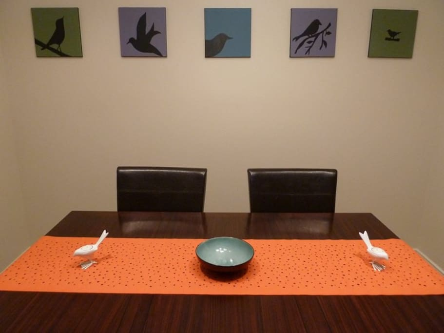 Dining Area - 4 chairs at the table, 2 bar stools.   I already put a bird on it too.