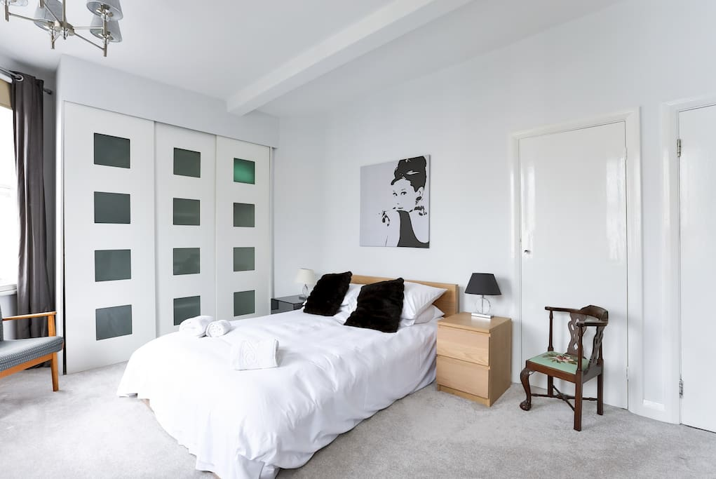 Large master bedroom with lots of storage space