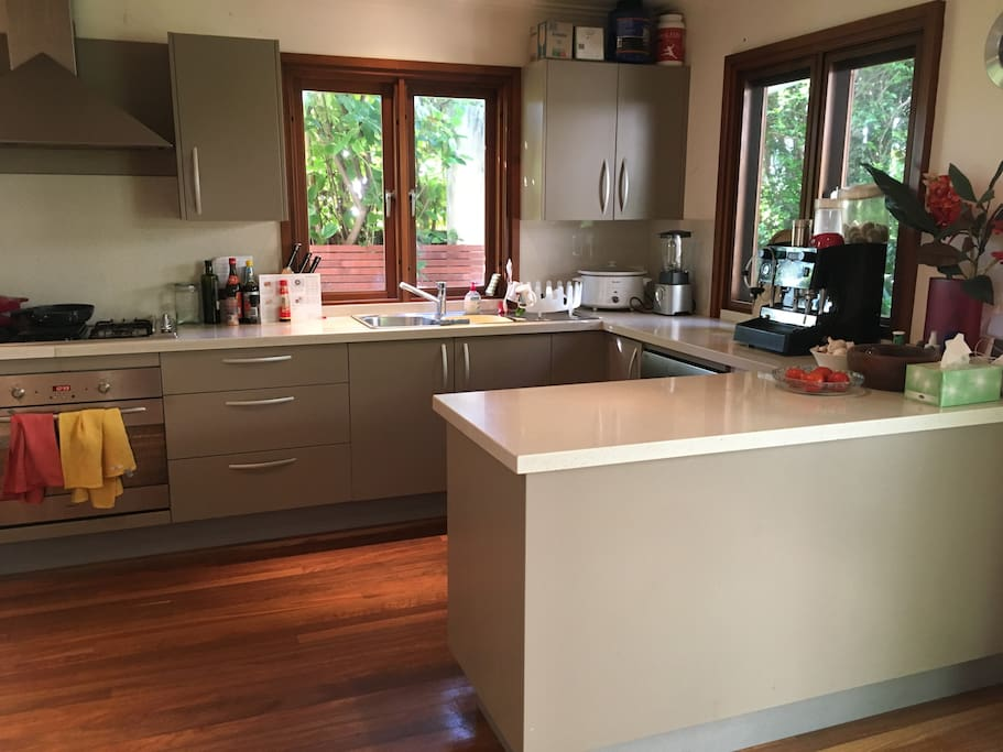 Spacious kitchen with espresso coffee machine and dishwasher