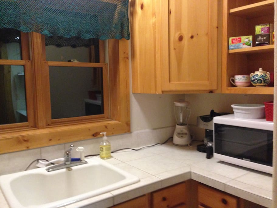 """""""Kitchenette"""" with microwave, toaster oven and coffee maker.  Refrigerator is around the corner in the garage."""