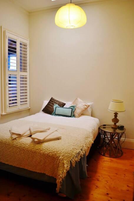 Raffles second bedroom with Queen bed.