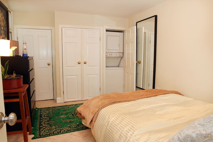 Bedroom (queen-size bed), including ample closet space and washer/dryer unit