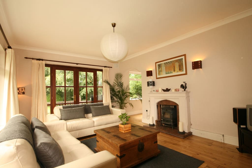 Sitting room, french doors leading to decking area. Solid fuel stove, straight to cozy-town