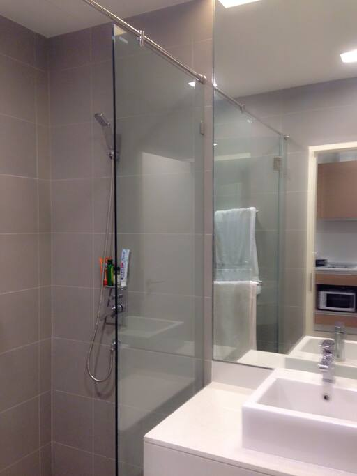 Shower with hot water heater and rain shower
