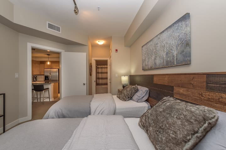 Two twin xl beds with the convenience to be converted into a king bed upon request.