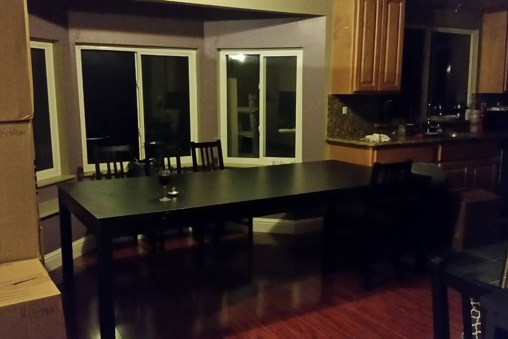 Dining table between the kitchen and living room