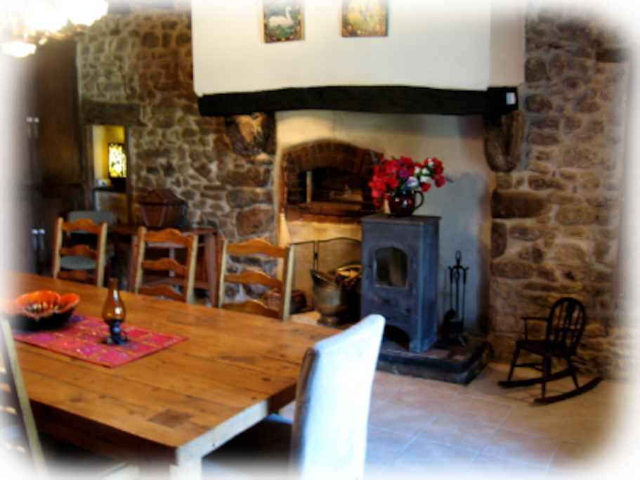 Dining room with fire and bread oven feature