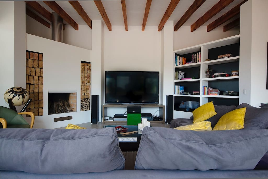 Comfortable Living Room with 80 inch TV and Chimney